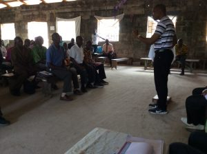 Man peaking at a gathering of pastors in Kakata, Margibi County