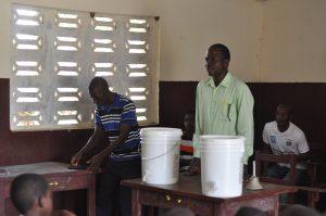 Alex Sackie, Principal of Demetah school receives Clean Drinking Water system